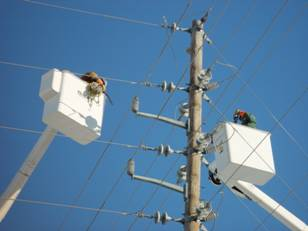 Men working on electric pole